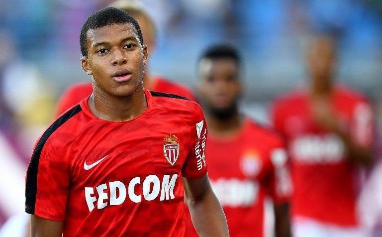 Monaco's French forward Kylian Mbappe warms up ahead of the French Trophy of Champions (Trophee des Champions) football match between Monaco (ASM) and Paris Saint-Germain (PSG) on July 29, 2017, at the Grand Stade in Tangiers. / AFP PHOTO / FRANCK FIFE