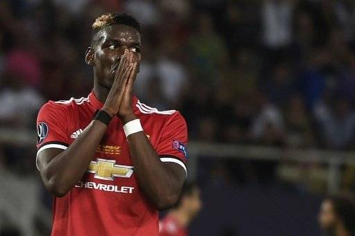 Manchester United's French midfielder Paul Pogba gestures during the UEFA Super Cup football match between Real Madrid and Manchester United on August 8, 2017, at the Philip II Arena in Skopje. / AFP PHOTO / Nikolay DOYCHINOV
