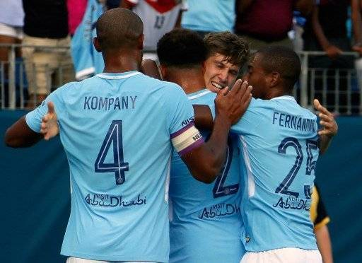 NASHVILLE, TN - JULY 29: John Stones #5 of Manchester City is congratulated by teamates Vincent Kompany #4 and Fernandinho #25 after scoring a goal against Tottenham during the first half of the 2017 International Champions Cup Presented by Heineken at Nissan Stadium on July 29, 2017 in Nashville, Tennessee. Frederick Breedon/Getty Images/AFP