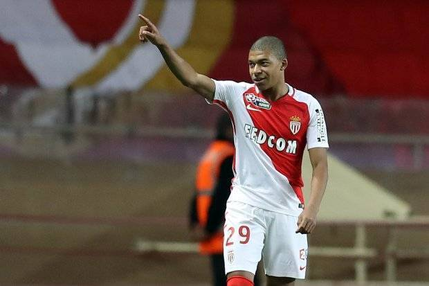 "Monaco's French forward Kylian Mbappe Lottin celebrates after scoring during a French League Cup football match between Monaco (ASM) vs Rennes (SRFC) at the ""Louis II"" stadium in Monaco on December 14, 2016. / AFP / VALERY HACHE (Photo credit should read VALERY HACHE/AFP/Getty Images)"