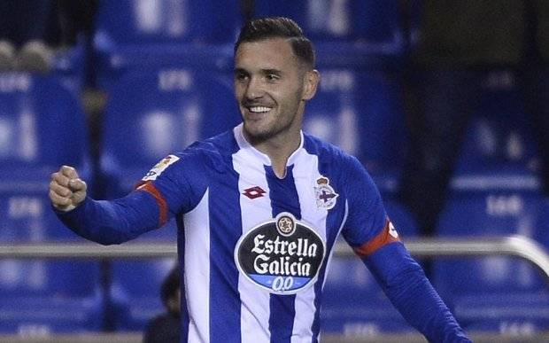 Deportivo La Coruna's midfielder Lucas Perez celebrates after scoring a goal during the Spanish league football match RC Deportivo de la Coruna vs Sevilla FC at the Municipal de Riazor stadium in La Coruna on December 5, 2015. AFP PHOTO / MIGUEL RIOPAMIGUEL RIOPA/AFP/Getty Images